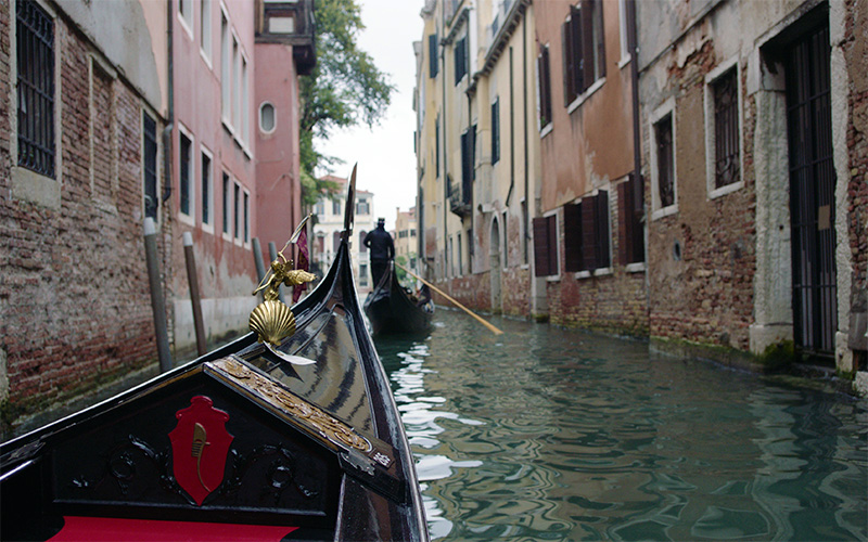Gondola on a canal of Venice